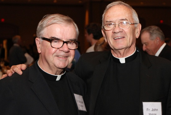 Father Michael O'Connell, left, poses with Father John Malone, his long-time friend, after the Trinity Sober Homes fall banquet Sept. 24. Dave Hrbacek/The Catholic Spirit