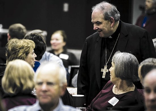 Archbishop Bernard Hebda gives his attention to a listening session participant Nov. 4 at the University of St. Thomas in St. Paul. Eric Wuebben/For The Catholic Spirit