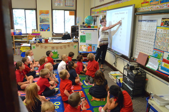 Teacher Maria Miller works on phonics with first-graders at St. Michael School in the town of St. Michael, MN. Bob Zyskowski/The Catholic Spirit
