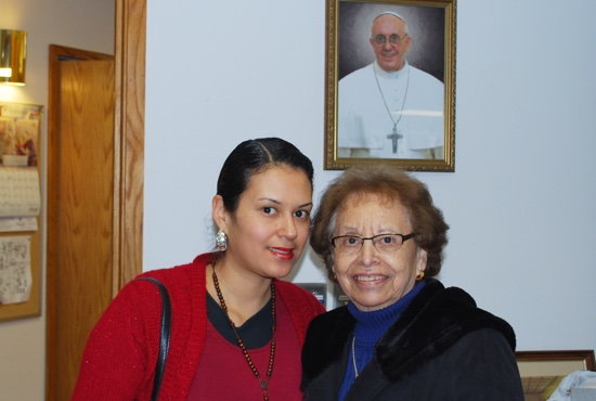 Mayra Mendez and Geraldine Lopez pose with a picture of Pope Francis in the vestibule of Our Lady of Guadalupe in St. Paul after Mass Feb. 14. Courtesy Juan Gutierrez