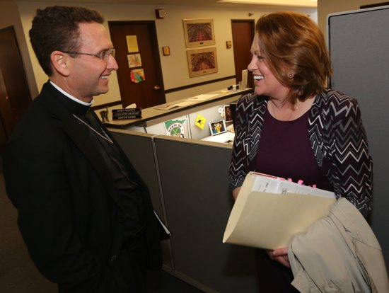 Bishop Andrew Cozens talks with Sen. Michelle Benson, R-Ham Lake, at the State Capitol March 16, a day in which Minnesota's six bishops visited the Capitol and met with Republican and Democratic legislators. Dave Hrbacek/The Catholic Spirit