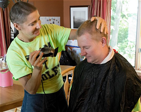After getting her hair cut by family members, Kristen Soley cuts her husband Nathan's hair. Courtesy Tina Fisher Photography