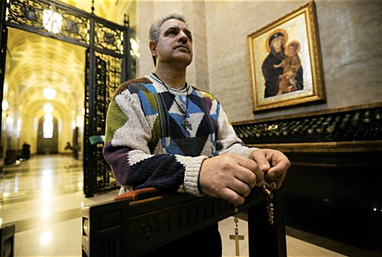 Tony Guajardo prays in the Piéta chapel at the Cathedral of St. Paul. It's one of his favorite places to lift up his prayer intentions. Other spots include the eucharistic adoration chapel and the Mary and Joseph chapels.