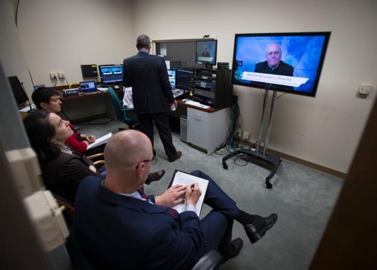 Media personnel at the U.S. Conference of Catholic Bishops in Washington monitor a live broadcast about Pope Francis' apostolic exhortation on family life April 8. CNS photo/Tyler Orsburn
