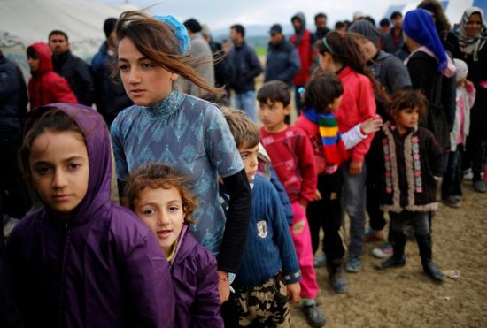 Young refugees wait in line for tea at a makeshift camp April 11 at the Greek-Macedonian border near the village of Idomeni, Greece. Pope Francis will travel to Lesbos, Greece, April 16. CNS photo/Stoyan Nenov, Reuters)