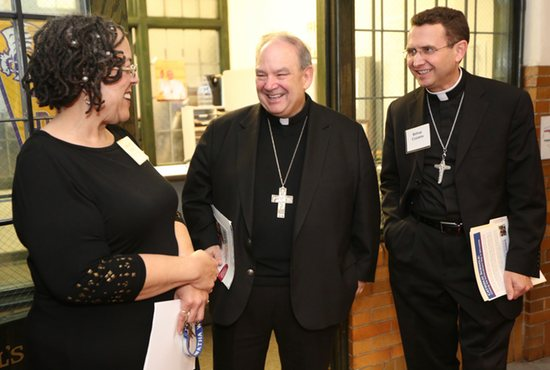 Archbishop Bernard Hebda and Bishop Andrew Cozzens visit with Dorwatha Woods, principal of Ascension Catholic School in Minneapolis during a tour April 22. Dave Hrbacek/The Catholic Spirit