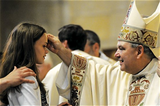 Archbishop Bernard Hebda confirms a youth April 17 at the Cathedral of St. Paul in St. Paul. Dianne Towalski/For The Catholic Spirit
