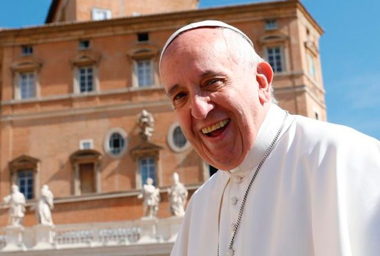 Pope Francis smiles as he arrives to lead his general audience in St. Peter's Square at the Vatican May 18. CNS photo/Paul Haring