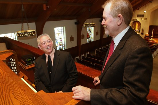 Organist Paul Cartier chats with Raymond Henderson, liturgical music director at Our Lady of Hope Parish in 2015 in Carle Place, N.Y. Organist Paul Cartier chats with Raymond Henderson, liturgical music director at Our Lady of Hope Parish in 2015 in Carle Place, N.Y. A new Department of Labor rule raises the salary threshold for overtime pay for many workers, meaning some parish staffs and other employers will have to readjust their budgets to accommodate the increased personnel costs. CNS/Gregory A. Shemitz