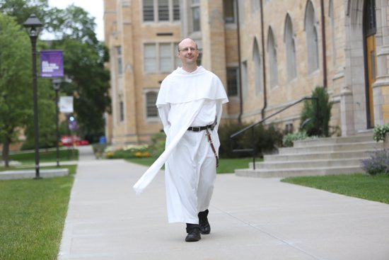 Dominican Father Patrick Tobin walks on campus June 23 at the University of St. Thomas in St. Paul June 23 where he teaches chemistry and serves as associate chaplain in campus ministry. Dave Hrbacek/The Catholic Spirit