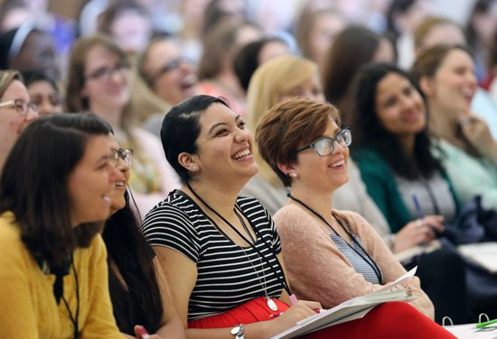 "Women laugh June 8 as they listen to keynote speaker Helen Alvare, a law professor at George Mason University in Arlington, Va., during ""Given,"" a leadership forum for young Catholic women at The Catholic University of America in Washington. The six-day event was sponsored by the Council of Major Superiors of Women Religious. CNS photo/Bob Roller"
