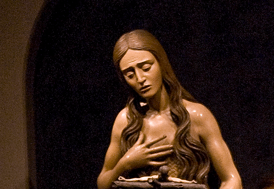 St. Mary Magdalene is shown meditating on the crucifix in this painted wooden sculpture that is part of The Sacred Made Real exhibit in 2010 at the National Galley of Art in Washington. CNS/Nancy Wiechec