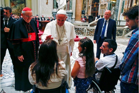 Pope Francis blesses a woman as he meets the disabled during the opening of the Diocese of Rome's annual pastoral conference at the Basilica of St. John Lateran in Rome June 16. CNS photo/Tony Gentile, Reuters
