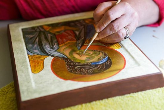 Marianist Brother Gary Marcinowski, a professor of sculpture at the University of Dayton, adds detail to an icon he created during a weeklong workshop on the ancient art form at the Shrine of St. Anthony in Ellicott City, Md., April 25. CNS photo/Kevin J. Parks, Catholic Review