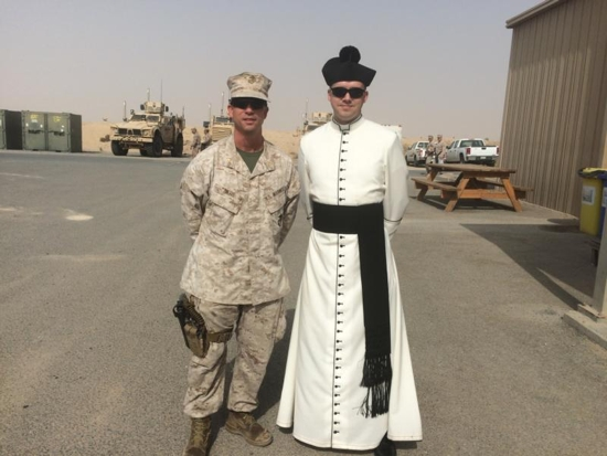 Father John Reutemann poses for a photo Oct. 18, 2015, with an unidentified major in the U.S. Marine Corps at Ahmed Al Jaber Air Base in Kuwait. Father Reutemann had been deployed to the combat zone as a chaplain in the U.S. Air Force. CNS photo/courtesy Father John Reutemann