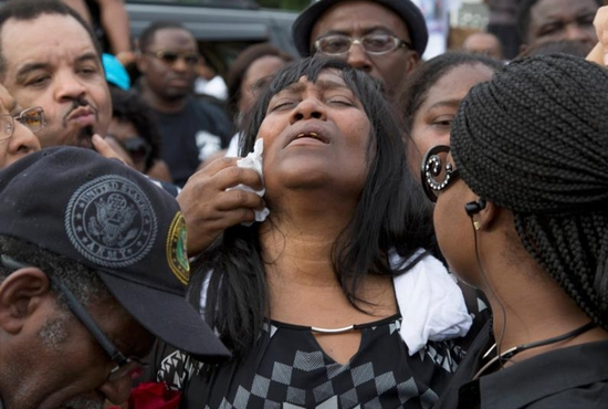 Sandra Sterling reacts during a July 7 vigil in memory of her nephew, Alton Sterling, who was shot dead by police outside a market in Baton Rouge, La. Sterling, 37, was killed early July 5 in a shooting that was captured on cellphone video. CNS photo/Jeffrey Dubinsky, Reuters