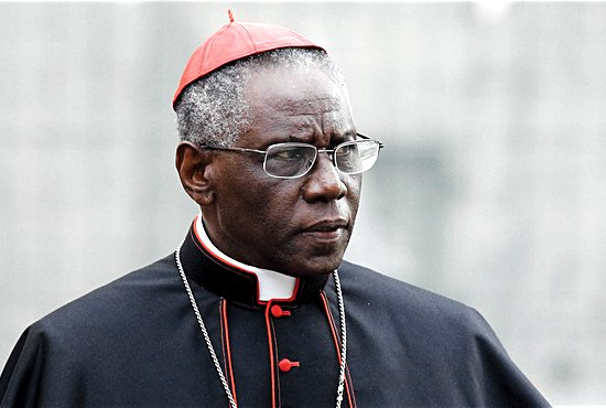 Cardinal Robert Sarah, prefect of the Congregation for Divine Worship and the Sacraments, is pictured at the Vatican in this Oct. 9, 2012, file photo. Cardinal Sarah, the Vatican's liturgy chief, has encouraged priests to begin celebrating the Eucharist facing east, the same direction the congregation faces. Cardinal Sarah made his request during a speech at the Sacra Liturgia conference in London  July 5. CNS/Paul Haring