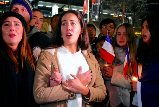 Members of the Australian French community mourn during a July 15 candlelight vigil in central Sydney to remember the victims of the Bastille Day truck attack in Nice, France. A truck loaded with weapons and hand grenades drove onto a sidewalk in Nice for more than a mile July 14, killing more than 80 people. CNS photo/David Gray, Reuters