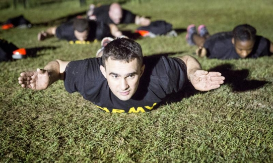 Father Adam Muda, a priest from the Diocese of Paterson, N.J., participates in physical training exercises at Fort Jackson in Columbia, S.C., in March as part of his training to become an Army chaplain. CNS photo/Chaz Muth