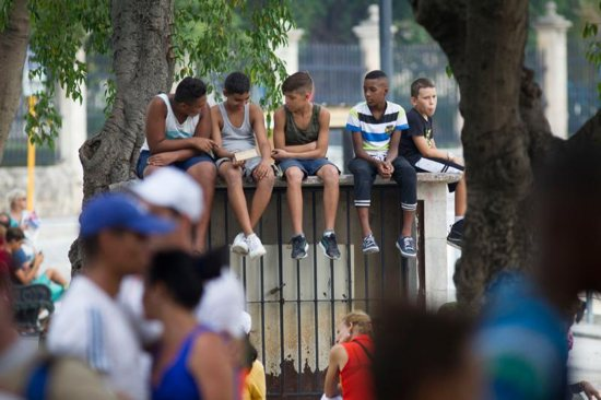 Boys wait for Pope Francis' arrival at the Father Felix Varela Cultural Center in Havana Sept. 20, 2015. To help young Cubans who could not afford the trip to World Youth Day in Krakow, Poland, feel more connected to the international gathering in Europe, the pope sent a video message to Havana. CNS photo/Tyler Orsburn