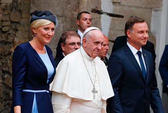 Pope Francis, Polish President Andrzej Duda and first lady Agata Kornhauser-Duda arrive for a meeting with government authorities and the diplomatic corps in the courtyard of Wawel Royal Castle in Krakow, Poland, July 27. CNS photo/Paul Haring