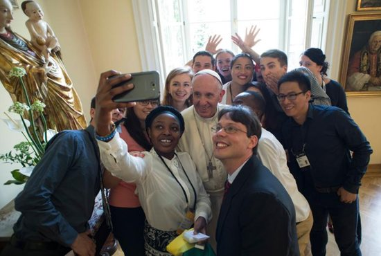 Pope Francis poses for a selfie with young people attending World Youth Day during a lunch in Krakow, Poland, July 30. CNS photo/L'Osservatore Romano, handout