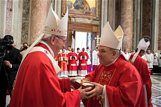 Pope Francis presents Archbishop Bernard Hebda with his pallium at the Vatican June 29, the feast of Sts. Peter and Paul. L'Osservatore Romano
