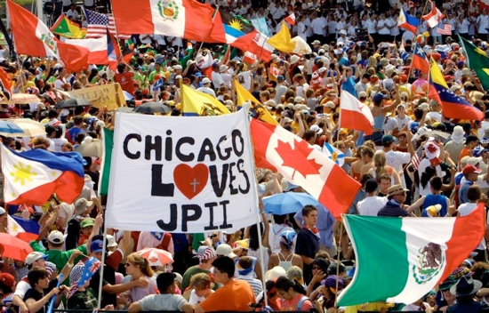 A large crowd, including Chicago youths and other World Youth Day pilgrims, gather to welcome St. John Paul II to Toronto in 2002. The largest U.S. group to attend a World Youth Day outside of North America, 30,000 American pilgrims plan to attend the July 26-31 festival in Krakow, Poland. They will join 2.5 million pilgrims from around the world. CNS photo/Nancy Wiechec