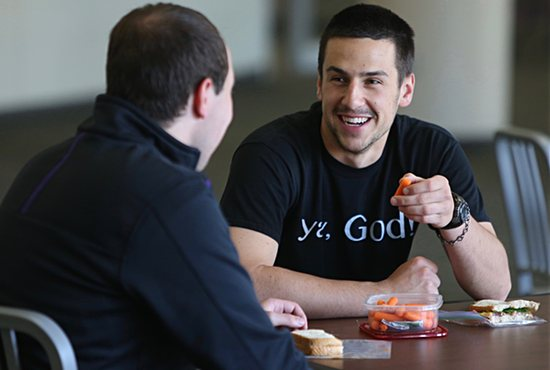 Austin Riordan, right, eats lunch and talks with student Robert Klemm. Dave Hrbacek/The Catholic Spirit