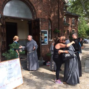 Conventual Franciscan friars greet the residents of the Greenpoint/Williamsburg section of Brooklyn, N.Y., Aug. 23, 2015, shortly after they opened their San Damiano Mission in the neighborhood, which had been the Holy Family (Slovak) Church. CNS photo/Ed Wilkinson