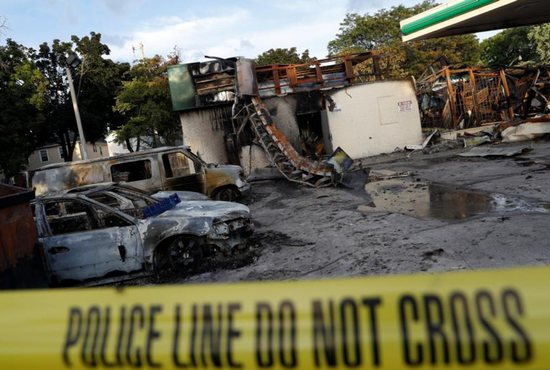 A gas station is seen Aug. 15 after it was burned down following the police shooting of a man in Milwaukee the previous day. CNS photo/Aaron P. Bernstein, Reuters