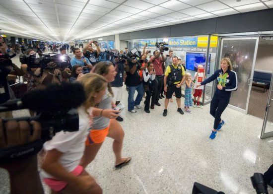 U.S. Olympic swimmer Katie Ledecky greets fans at Dulles International Airport in Virginia Aug. 17, after returning home from the Summer Games in Rio de Janeiro. CNS photo/Jaclyn Lippelmann, Catholic Standard)