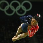 Gymnast Simone Biles keeps rosary — a gift from her mom — close when she competes