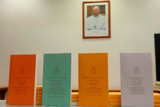 "Copies of Pope Francis' apostolic exhortation on the family, ""Amoris Laetitia"" (""The Joy of Love""), are seen during the document's release at the Vatican April 8. The exhortation is the concluding document of the 2014 and 2015 synods of bishops on the family. CNS photo/Paul Haring"