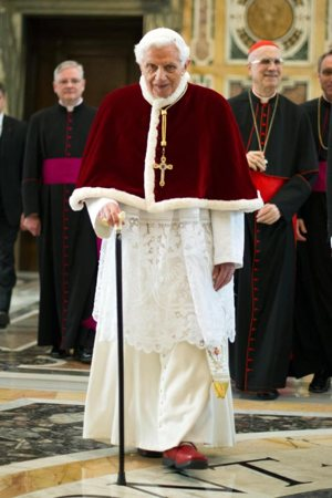 Pope Benedict XVI walks with his cane in 2013 at the Vatican following his final general audience. Retirement has given the 89-year-old Pope Benedict what he describes as the gift of silence to enter more deeply into prayer, especially with the Psalms and the writings of early church theologians. CNS photo/L'Osservatore Romano