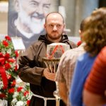 Different reasons draw Catholics to venerate St. Padre Pio relic