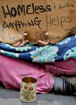 A homeless woman sits on a sidewalk in 2014 in New York City. Despite there being 46.7 million Americans living in poverty, there has been little talk about the needs of poor people on the presidential campaign trail. CNS photo/Justin lane, EPA