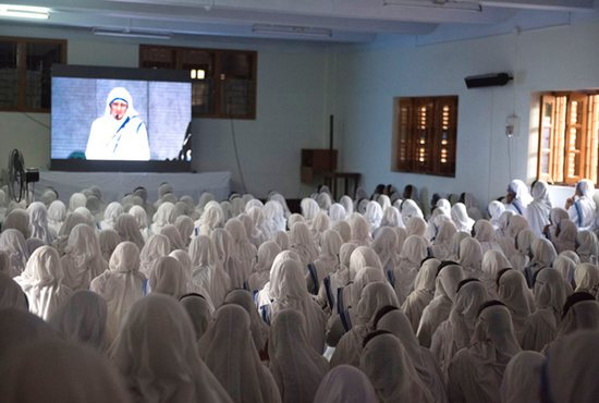 Missionaries of Charity nuns in Kolkata, India, watch St. Teresa's canonization broadcast live from Rome Sept. 4. CNS photo/Jeffrey Bruno