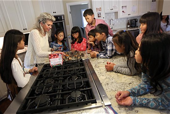 Jean Mulvahill works with her kids to make afternoon snacks in the kitchen. Dave Hrbacek/The Catholic Spirit