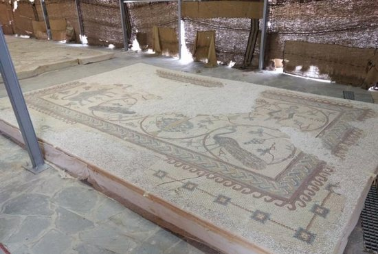 Restored mosaics are seen on display in front of the Memorial of Moses on the top of Mount Nebo in Jordan Oct. 10. The memorial has reopened its doors to the public amid festivities after a nearly decade of restoration. CNS photo/Greg Tarczynski