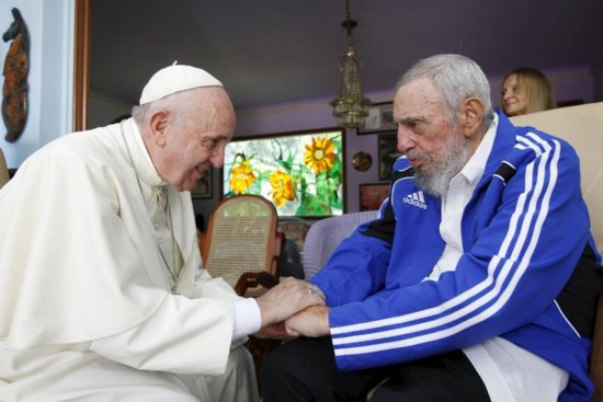 Pope Francis and former Cuban President Fidel Castro grasp each other's hands at Castro's residence in Havana Sept. 20, 2015. Castro, who seized power in a 1959 revolution and governed Cuba until 2006, died Nov. 25 at the age of 90. CNS photo/Alex Castro, AIN handout via Reuters