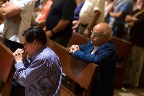 Local Cubans pray at Our Lady of Charity National Shrine in Miami Nov. 26. The death of former Cuban leader Fidel Castro triggered both excitement and a more subdued reaction among Cuban exiles in Miami. CNS/Tom Tracy
