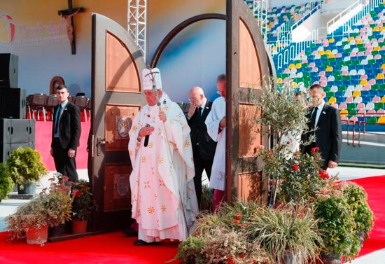 Pope Francis walks through a Holy Door as he arrives to celebrate Mass at Mikheil Meskhi Stadium in Tbilisi, Georgia, Oct. 1. CNS photo/Paul Haring