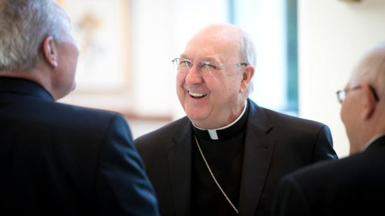 Bishop Kevin Farrell, who headed the Dallas Diocese from 2007 until mid-August, laughs with other bishops at the U.S. Conference of Catholic Bishops' building in Washington Sept. 13. He is now the prefect of the new Vatican office for laity, family and life. CNS photo/Tyler Orsburn