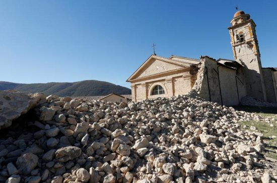 St. Anthony Church is seen Oct. 30 partially collapsed following an earthquake along the road to Norcia, Italy. Thousands of people in central Italy have spent the night in cars, tents and temporary shelters following the fourth earthquake in the area in three months. CNS photo/Remo Casilli, Reuters
