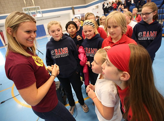 Katie Spotz, left, talks with students at Sacred Heart Catholic School in Robbinsdale after her presentation there Nov. 15. Dave Hrbacek/The Catholic Spirit