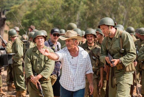 """Director Mel Gibson, center, is seen on the set of """"Hacksaw Ridge."""" The movie marks Gibson's return to the director's chair after a 10-year absence. CNS photo/Lionsgate"""
