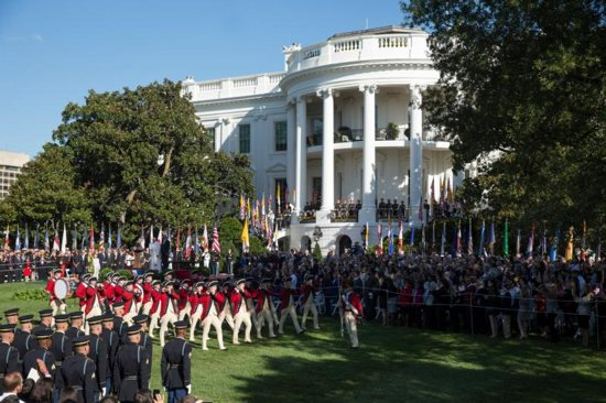 The Fife and Drum Corps marches past U.S. President Barack Obama and Pope Francis during an arrival ceremony on the South Lawn of the White House in Washington Sept. 23, 2015. The White House is part of the National Park Service system. CNS photo/Joshua Roberts
