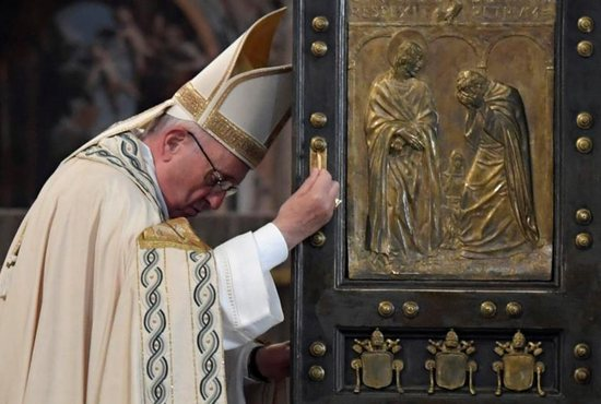 Pope Francis closes the Holy Door of St. Peter's Basilica to mark the closing of the jubilee Year of Mercy at the Vatican Nov. 20. (CNS photo/Tiziana Fabi, pool via Reuters