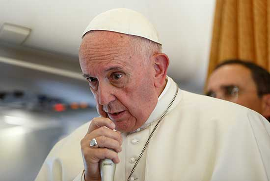 Pope Francis answers questions from journalists aboard his flight from Malmo, Sweden, to Rome Nov. 1. CNS/Paul Haring